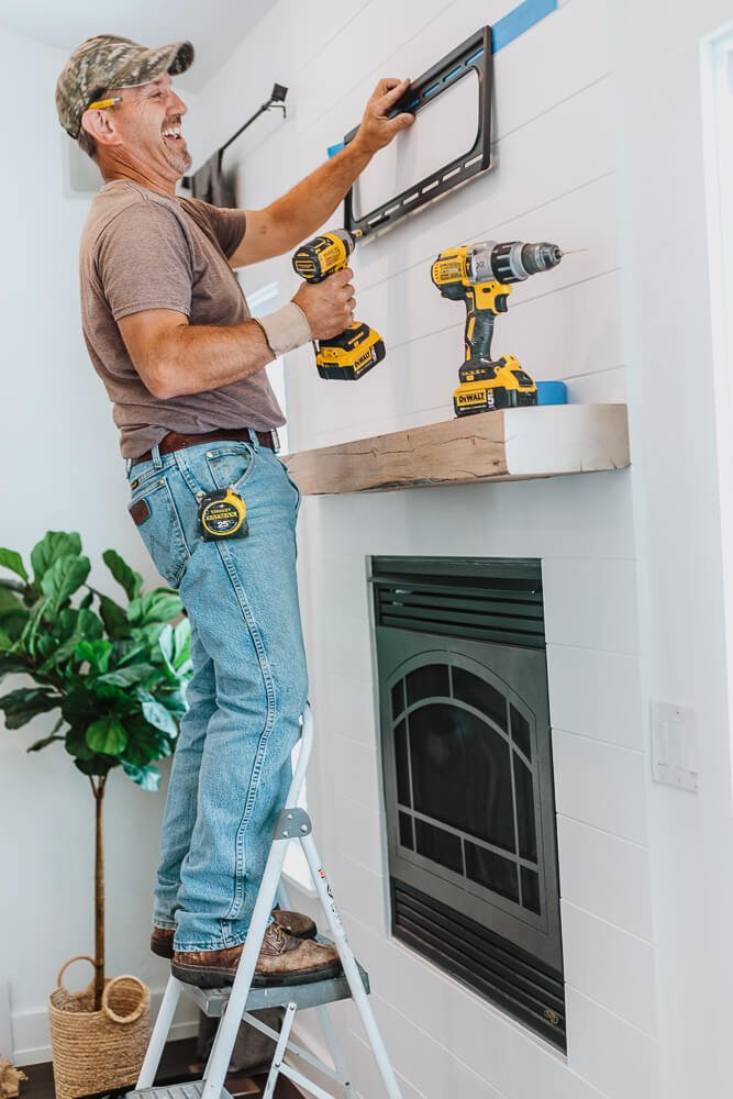handyman in cache valley utah installing a television mount